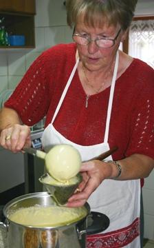 Cook making fennel cake batter