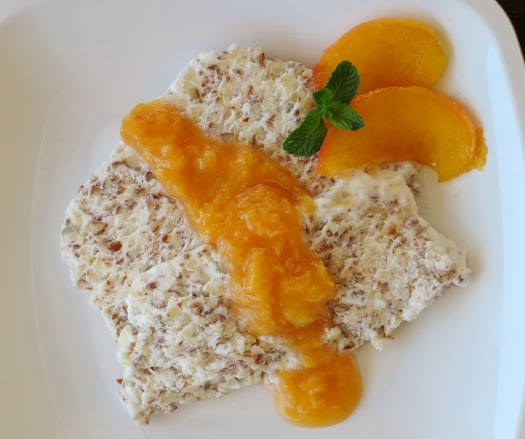 semifreddo alle mandorle with peach sauce