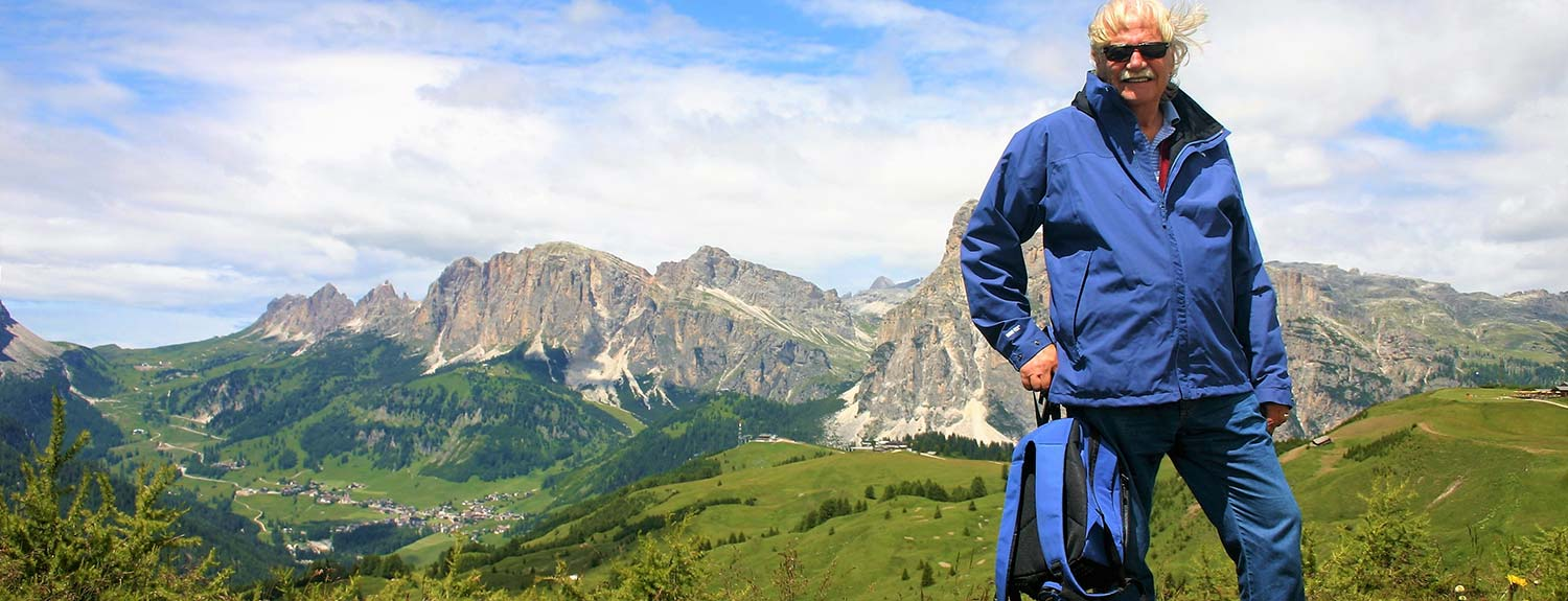 Man standing with Dolomites in the background