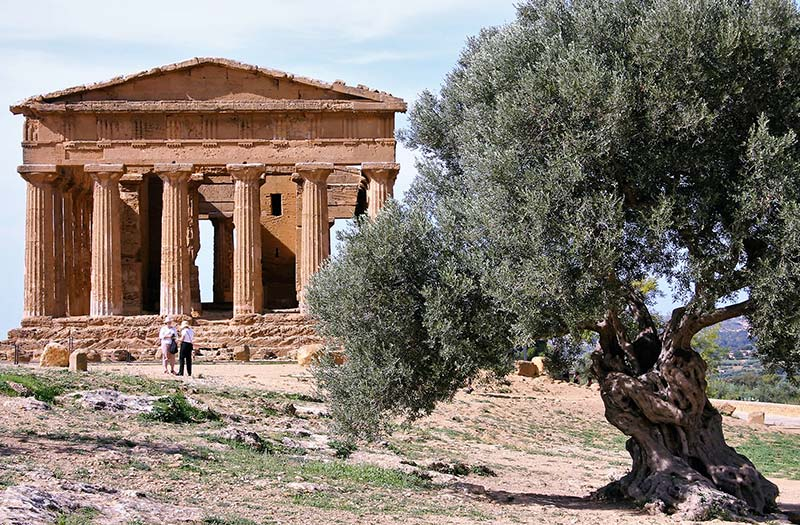 Walking tour group at Greek temple in Agrigento, Sicily