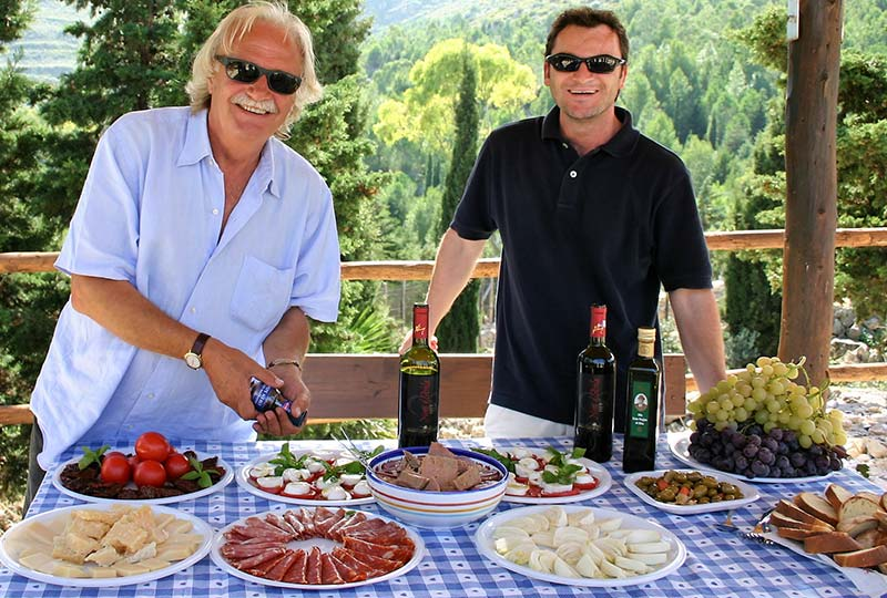 tour guides with a table full of Italian cuisine