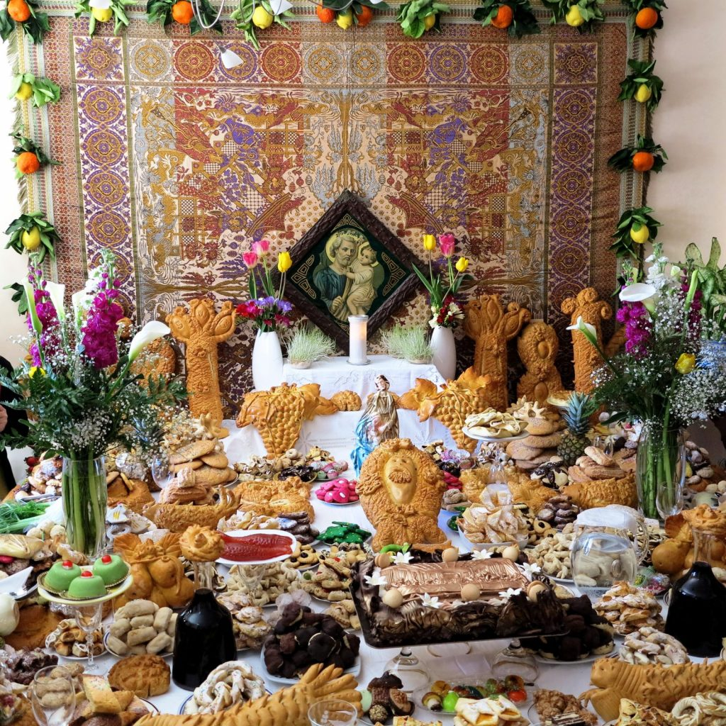 St. Joseph's table with elaborate breads are featured on our Festival Tour of Sicily in honor of San Giuseppe